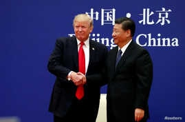 U.S. President Donald Trump and China's President Xi Jinping meet business leaders at the Great Hall of the People in Beijing, Nov. 9, 2017.