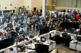 FILE - In this Jan. 2, 2015  photo, people line up at a California Department of Motor Vehicles office to register for drivers licenses in Stanton, California, where 59,000 driver's licenses were issued to   immigrants who are  in the U.S. illegally.