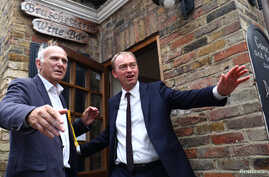 Liberal Democrat leader Tim Farron and former Business Secretary Vince Cable campaign for the forthcoming general election, in Twickenham, Britain, June 7, 2017.