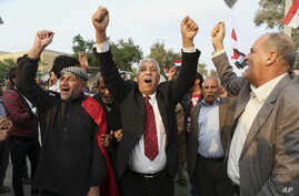Protesters shout slogans against the Turkish government during a demonstration calling for the withdrawal of Turkish troops from northern Iraq, in Basra, Iraq, Dec. 18, 2015.