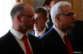 Prime Minister Andrej Babis walks past newly appointed members of the Czech government during the cabinet's inauguration at Prague Castle in Prague, Czech Republic Dec. 13, 2017.