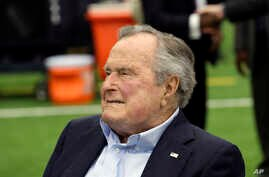 FILE - Former President George H.W. Bush arrives for an NFL football game between the Houston Texans and the Indianapolis Colts, Nov. 5, 2017, in Houston.
