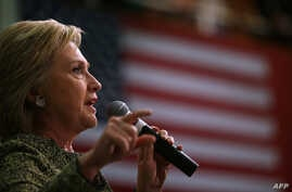"""Democratic presidential candidate former Secretary of State Hillary Clinton speaks during a """"Get Out The Vote"""" rally at the University of Arkansas-Pine Bluff in Pine Bluff, Arkansas, Feb. 28, 2016."""