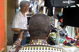 A Chinese salesman sells consumer goods in Abidjan, Ivory Coast