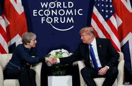 President Donald Trump meets with British Prime Minister Theresa May at the World Economic Forum, Jan. 25, 2018, in Davos, Switzerland.