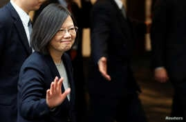 FILE - Taiwan President Tsai Ing-wen leaves a luncheon during a stop-over after her visit to Latin America in Burlingame, California, U.S.