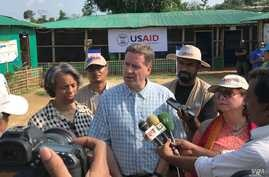 USAID Administrator Mark Green, center, speaks to reporters at the Balukhali Rohingya refugee camp in Cox's Bazar, Bangladesh, May 15, 2018.