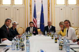 FILE - U.S. Secretary of Energy Ernest Moniz, U.S. Secretary of State John Kerry and U.S. Under Secretary for Political Affairs Wendy Sherman (L-3rd L) meet with European Union foreign policy chief Federica Mogherini (2nd R) at a hotel in Vienna, Aus