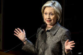 Democratic presidential candidate Hillary Clinton speaks before presenting The Hillary Rodham Clinton Awards for Advancing Women in Peace and Security, in the Riggs Library at Georgetown University in Washington, D.C., April 22, 2015.