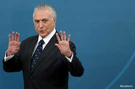 Brazil's President Michel Temer gestures during a ceremony at the Planalto Palace in Brasilia, Brazil, March 7, 2017.