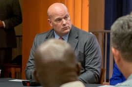 FILE - Then-Chief of Staff to the Attorney General Matthew Whitaker attends a roundtable discussion at the Justice Department in Washington, Aug. 29, 2018.