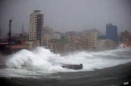 FILE - In this Sept. 9, 2017 file photo, strong waves brought by Hurricane Irma hit the Malecon seawall in Havana, Cuba. The elegant, seaside boulevard, where early 20th-century buildings are pounded with massive waves during storms and cold fronts,