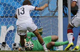 Germany's Thomas Mueller kicks to score his team's fourth goal, his third in the match, past Portugal's Rui Patricio during their 2014 World Cup Group G soccer match at the Fonte Nova arena in Salvador, June 16, 2014.