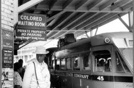 A sign in a bus station in Durham, N.C. points the way to a segregated waiting room
