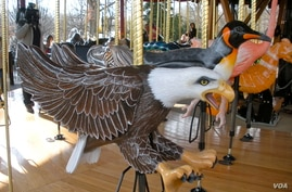The animals depicted on the National Zoo's Conservation Carousel include many endangered species. (VOA/J. Taboh)