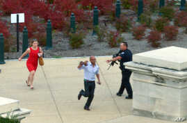 People run for cover as police converge to the site of a shooting October 3, 2013 on Capitol Hill in Washington, DC.