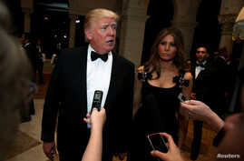 U.S. President-elect Donald Trump talks to reporters as he and his wife Melania Trump arrive for a New Year's Eve celebration with members and guests at the Mar-a-lago Club in Palm Beach, Florida, Dec. 31, 2016.