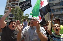 Supporters of Lebanese hard-line Sunni cleric Sheik Ahmad al-Assir hold a Syrian revolution flag and chant slogans against Hezbollah during a demonstration after the Friday prayer, in Beirut, Lebanon, July 5, 2013.