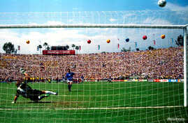 FILE - Italy's Roberto Baggio puts his penalty over the bar in the World Cup final against Brazil at the Rose Bowl in Pasadena, California, July 17, 1994.