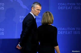 European Union Foreign Minister Federica Mogherini speaks with NATO Secretary General Jens Stoltenberg during the Global Coalition - Working to Defeat ISIS at the State Department in Washington, March 22, 2017.