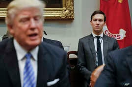 FILE -  White House Senior Adviser Jared Kushner, right, listens to President Donald Trump speak during a breakfast with business leaders in the Roosevelt Room of the White House in Washington.