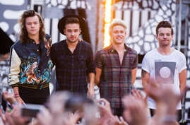 """FILE - One Direction members, from left, Harry Styles, Liam Payne, Niall Horan and Louis Tomlinson perform on ABC's """"Good Morning America""""."""