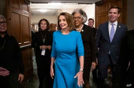 House Democratic Leader Nancy Pelosi of California, joined at by Rep. Joyce Beatty, D-Ohio, and Rep. Eric Swalwell, D-Calif., emerges victorious from the Democratic Caucus leadership elections at the Capitol in Washington, Nov. 28, 2018.