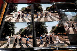 Five alternate pictures for the cover of Abbey Road are displayed by French Beatles specialist and collector Jacques Volcouve, one of the world's greatest living experts of the band, at Drouot auction house in Paris, March 16, 2017.
