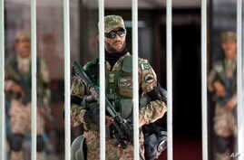 Pakistani army soldiers guard the parliament building during an emergency session in Islamabad as thousands of protesters demanding the prime minister's resignation, Sept. 2, 2014.