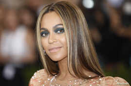 "FILE - Singer-Songwriter Beyonce Knowles arrives at the Metropolitan Museum of Art Costume Institute Gala (Met Gala) to celebrate the opening of ""Manus x Machina: Fashion in an Age of Technology"" in the Manhattan borough of New York."
