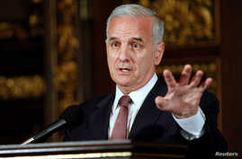 FILE - Minnesota Gov. Mark Dayton speaks to media in St. Paul, Minnesota, July 20, 2011.