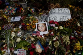 A photo of Heather Heyer, who was killed during a white nationalist rally, sits on the ground at a memorial the day her life was celebrated at the Paramount Theater in Charlottesville, VA.