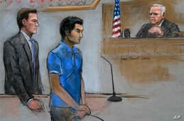 In this courtroom sketch, defendant Dias Kadyrbayev, center, a college friend of Boston Marathon bombing suspect Dzhokhar Tsarnaev, is depicted, Aug. 21, 2014 in federal court in Boston during a hearing where he pleaded guilty before Judge Douglas P.