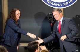 FILE - Nebraska 2nd District Rep. Don Bacon, a Republican and his challenger Democrat Kara Eastman break away from a handshake following a debate in Omaha, Nebraska, Oct. 18, 2018.