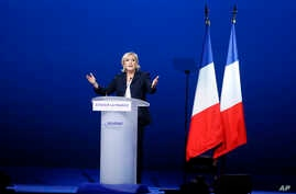 French far-right presidential candidate Marine Le Pen attends her meeting, May 1, 2017, in Villepinte, outside Paris.