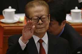 Former Chinese President Jiang Zemin gestures during the opening session of the 18th Communist Party Congress held at the Great Hall of the People in Beijing, China, Nov. 8, 2012.