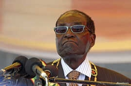 President Robert Mugabe waits to address crowds gathered for Zimbabwe's Heroes Day commemorations in Harare, August 10, 2015.