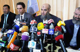 Younes Makhyoun, second from right, head of the Salafist al-Nour Party, at party headquarters, Cairo, Aug. 28, 2013 file photo.