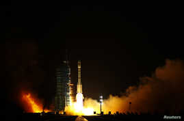 FILE - The Long March II-F rocket loaded with China's unmanned space module Tiangong-1 lifts off from the launch pad in the Jiuquan Satellite Launch Center, Gansu province.