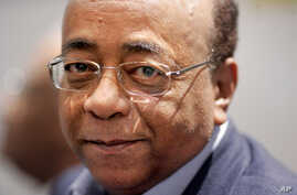 Mo Ibrahim poses for photographs before speaking at the launch of the Mo Ibrahim Foundation in London, Friday Oct. 27, 2006.