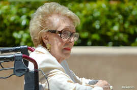 FILE - Former first lady of the United States Nancy Reagan visits the grave site of her husband, former United States President Ronald Reagan, on the 10th anniversary of his passing, in Simi Valley, California June 5, 2014.