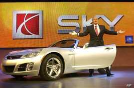 Gary Cowger, President, General Motors North America, steps out of new 2007 Saturn Sky Roadster during rehearsal for its formal unveiling, North American International Auto Show, Detroit, Jan. 9, 2005.