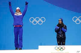 Women's cross-country 7.5/7.5km skiathlon gold medalist Charlotte Kalla, of Sweden, center, applauds as silver medalist Marit Bjoergen, of Norway, reacts during their medals ceremony at the 2018 Winter Olympics in Pyeongchang, South Korea, Feb. 10, 2