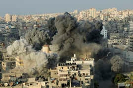 Smoke rises from an explosion caused by an Israeli airstrike on a building of Said al-Mis'hal cultural center in Gaza City, Aug. 9, 2018. Palestinian officials say Israeli warplanes have attacked the cultural center in Gaza City. The Palestinian Heal
