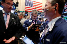 Traders work on the floor of the New York Stock Exchange (NYSE) shortly after the opening bell in New York, U.S., Aug. 9, 2016.