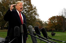 President Donald Trump talks to the media before boarding Marine One on the South Lawn of the White House, Nov. 9, 2018, in Washington.