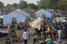 People gather at a makeshift camp at the United Nations Mission in South Sudan (UNMISS) compound in Juba Dec. 22, 2013.