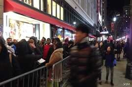 "The crowd outside Macy""s Herald Square flagship store in New York City, ahead of the store opening on Thanksgiving, Nov. 28, 2013. (Photo Sandra Lemaire )"