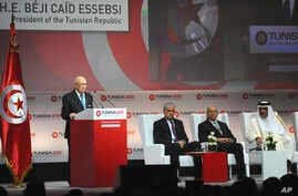 """Tunisian President Beji Caid Essebsi (L) delivers his speech during the opening ceremony of """"Tunisia 2020,"""" an international investment conference, in Tunis, Tunisia, Nov. 29, 2016."""