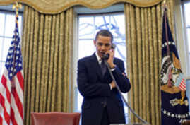 US President Barack Obama discusses the START treaty, during a phone call with his Russian counterpart Dmitry Medvedev in the Oval Office , 26 Mar 2010